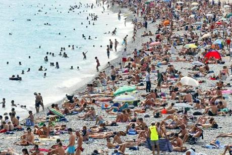 Sunbathers relaxed on the French Riviera in Nice last month. France mandates 30 paid vacation days per year.